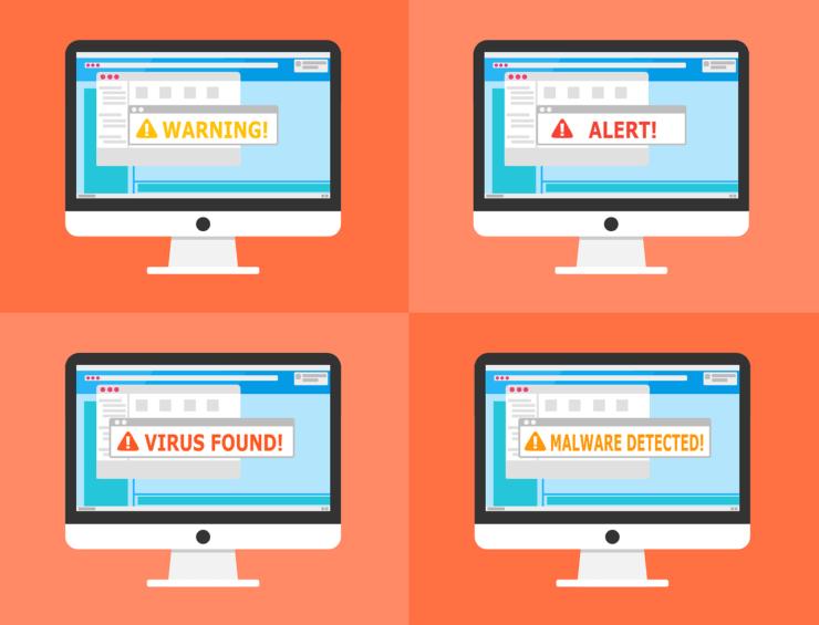4つのパソコン画面に警告やアラート