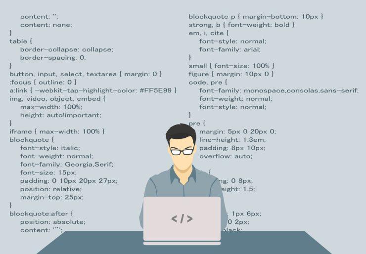 プログラミングをする男性画像